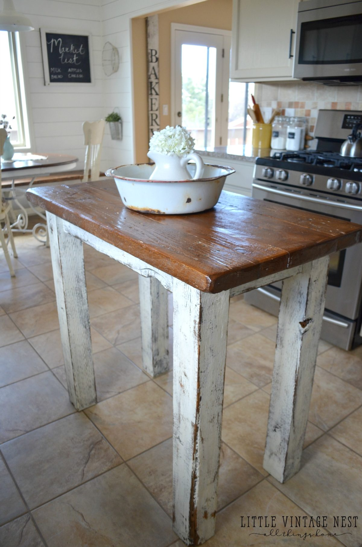 Rustic farmhouse style kitchen island made from reclaimed barn wood.