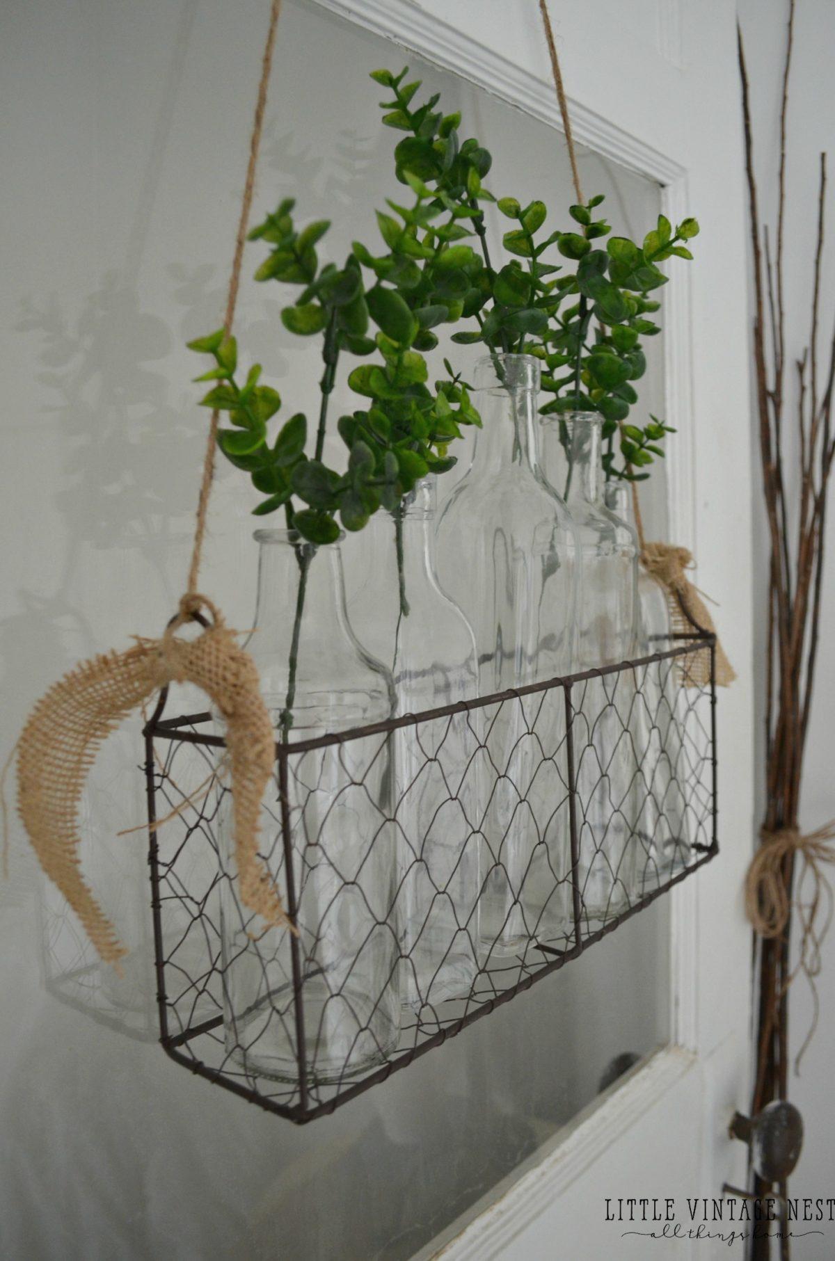Hanging Basket on Door with Glass Bottles