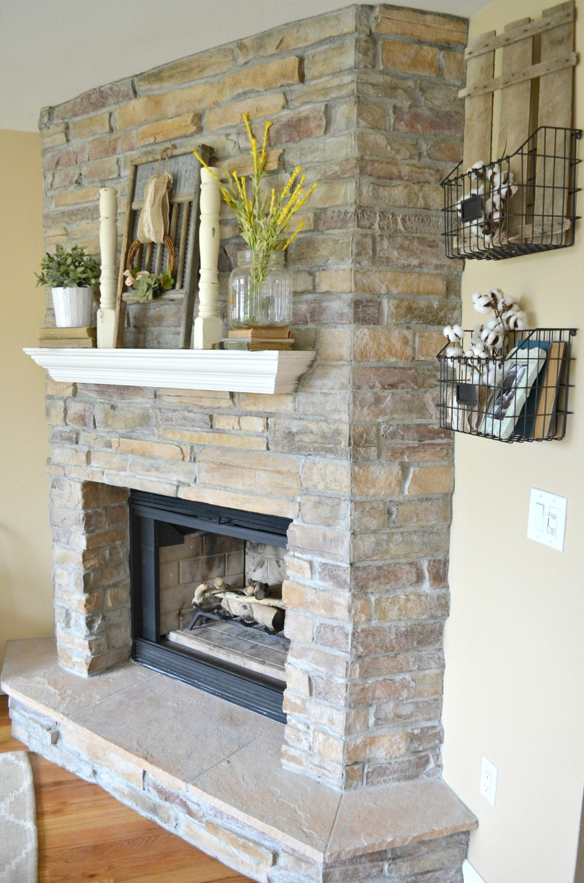 Summertime mantel and fireplace with vintage decor
