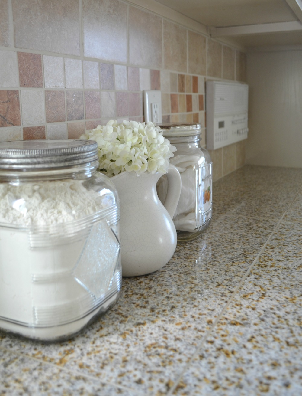 Farmhouse kitchen breakfast nook tour little vintage nest for Kitchen jar decoration