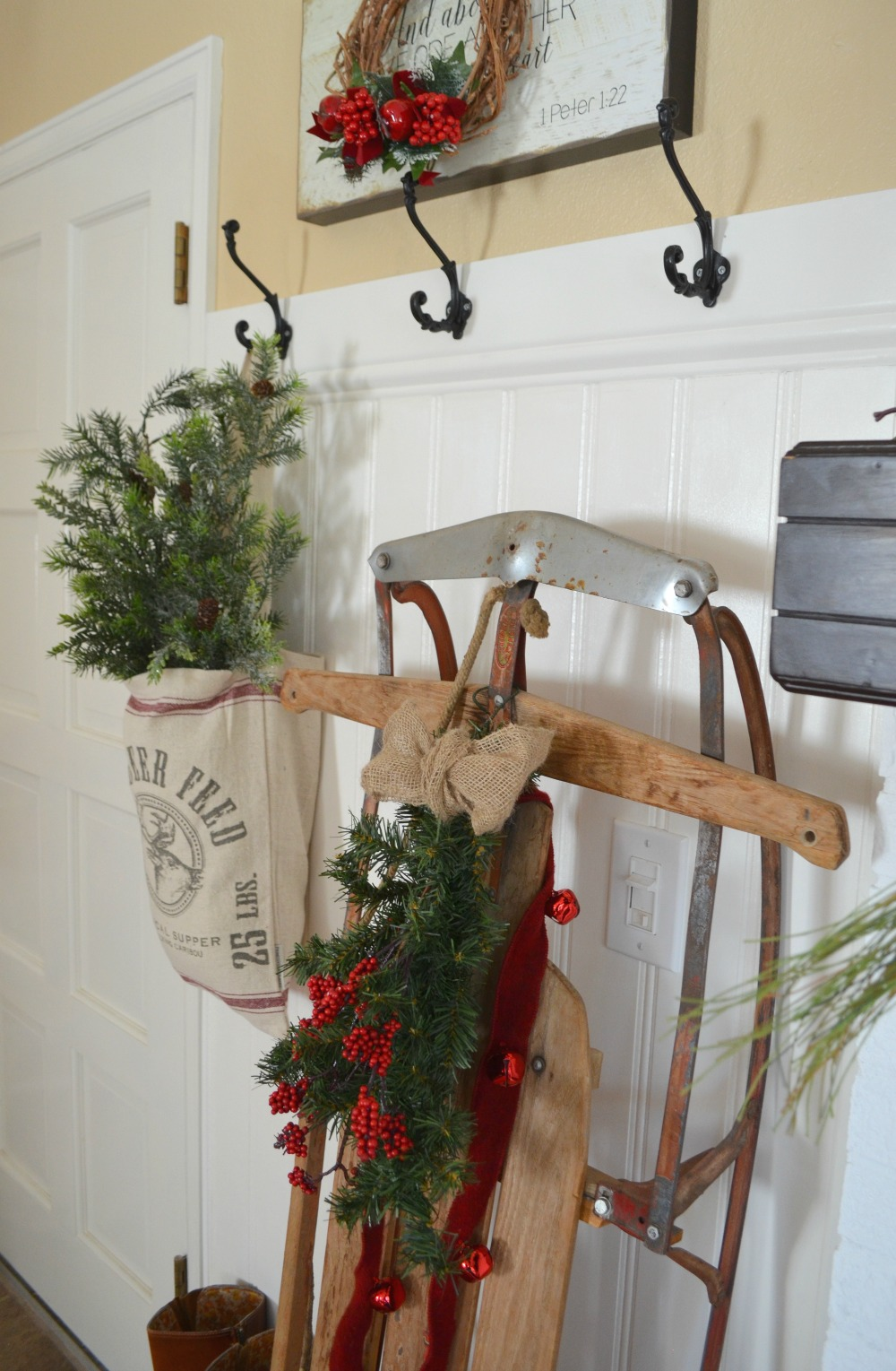 A vintage christmas entryway little vintage nest for Antique sled decoration