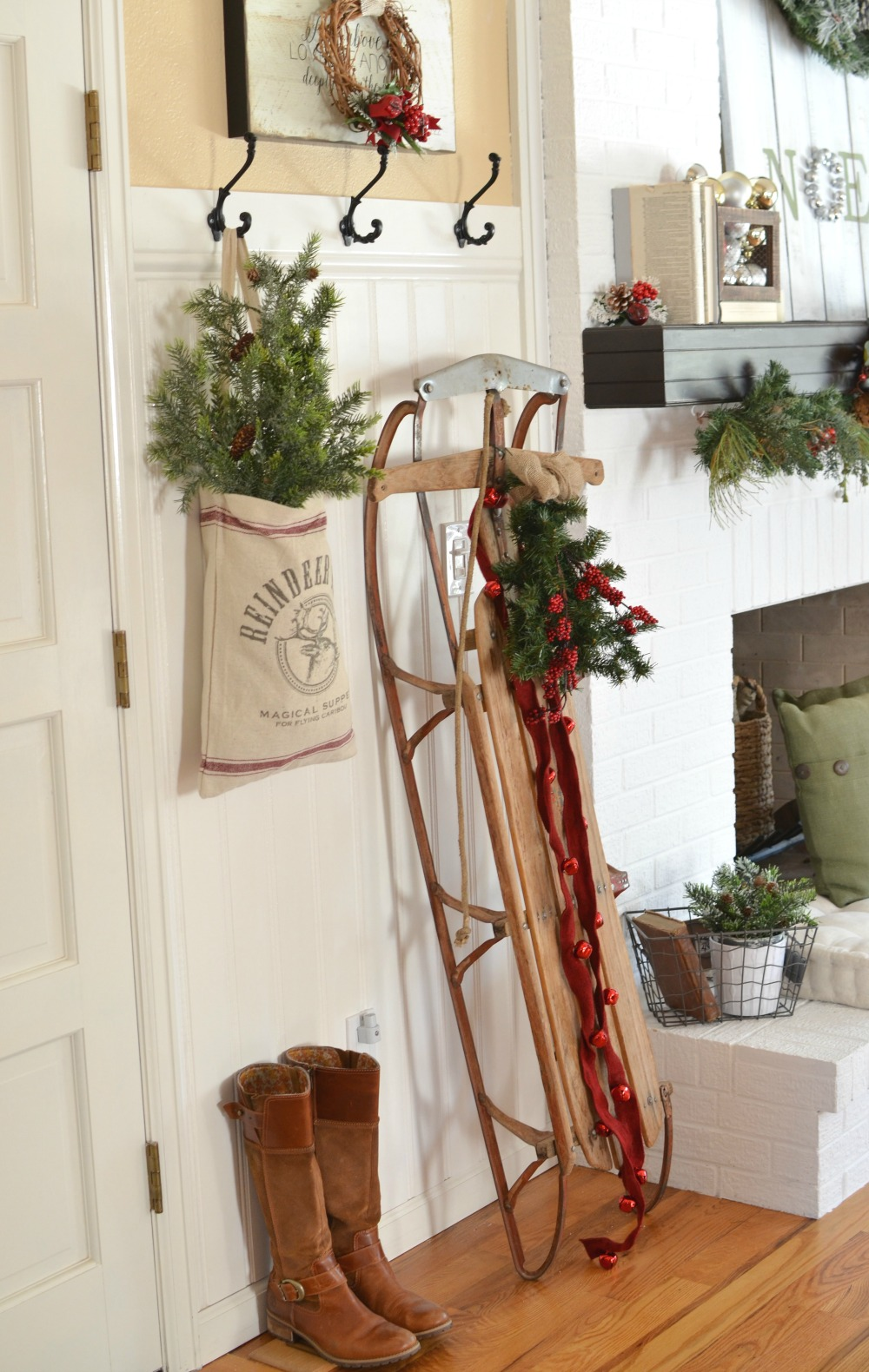 a vintage christmas entryway farmhouse christmas decor vintage sled christmas decor