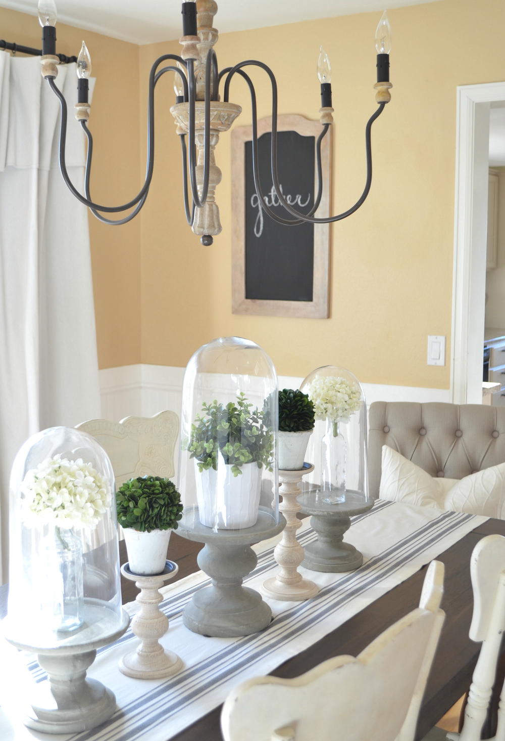 10 Ways to Get Farmhouse Style in Your Home. Farmhouse style light fixture.