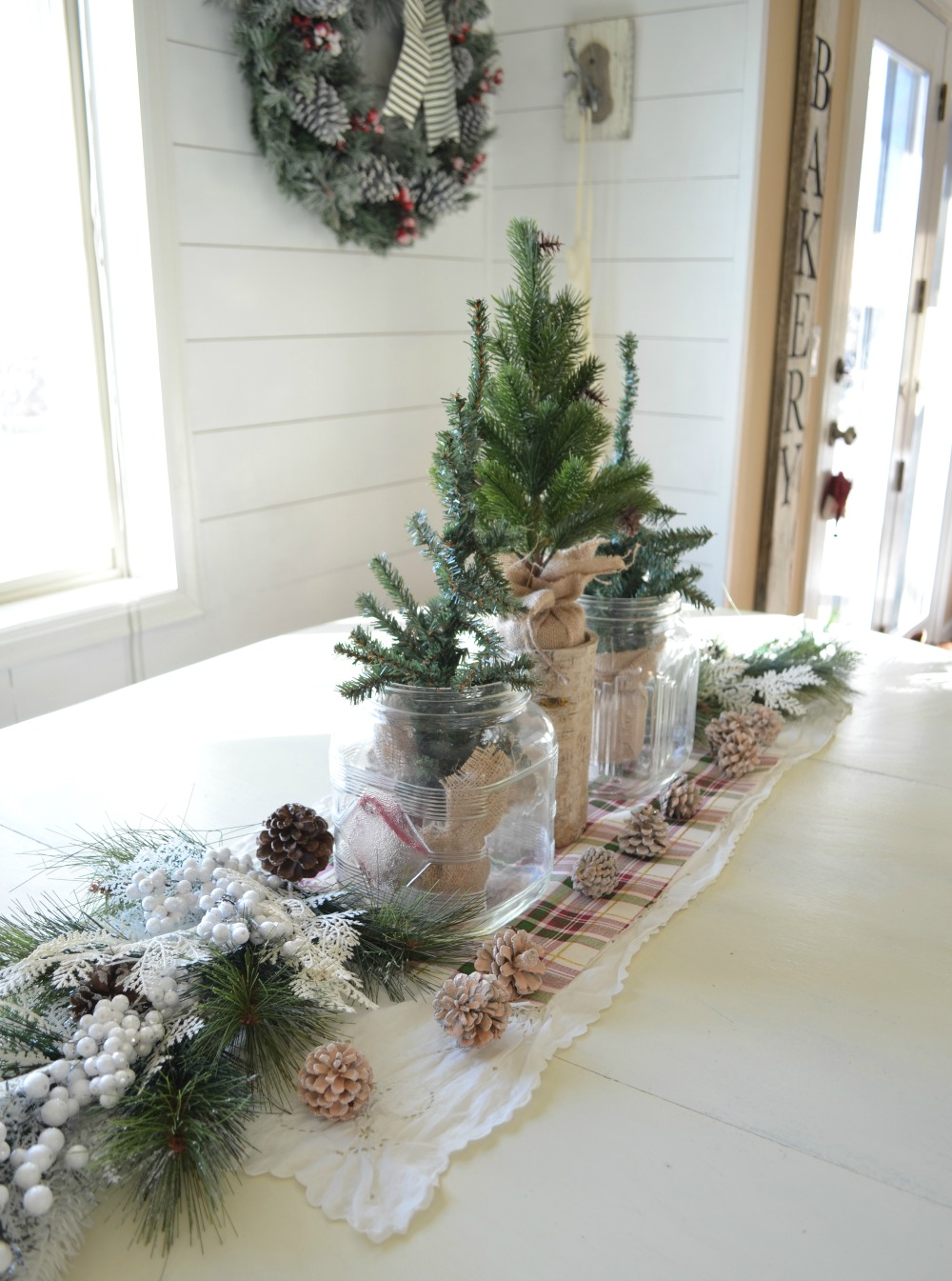 Simple Farmhouse Christmas Centerpiece. A simple vintage inspired centerpiece perfect for the holiday season!