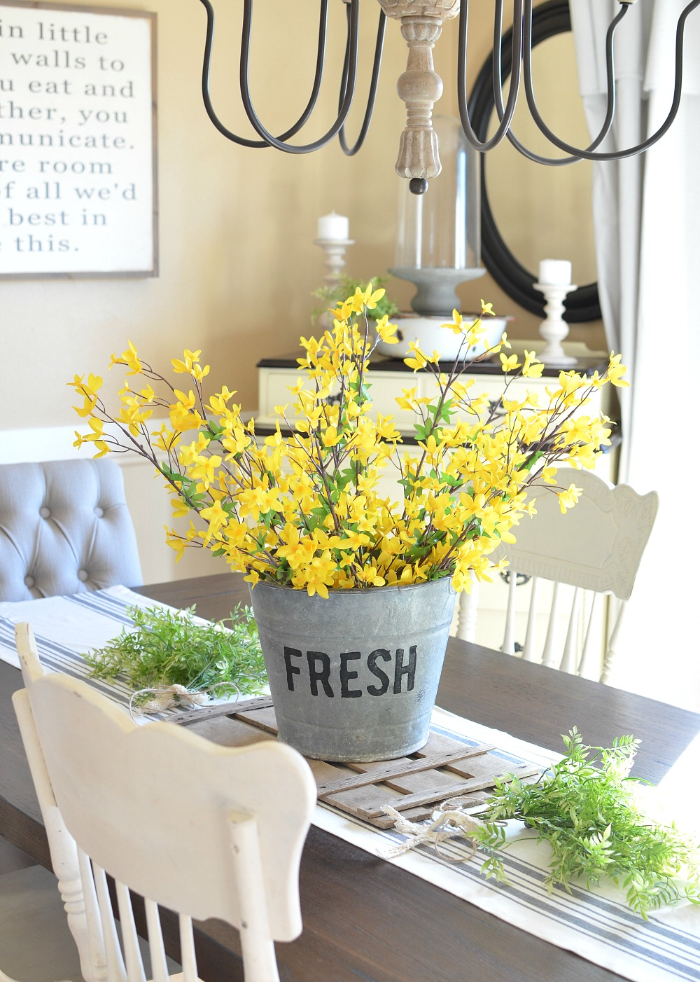 DIY Bucket of Flowers Centerpiece. Beautiful farmhouse centerpiece for spring