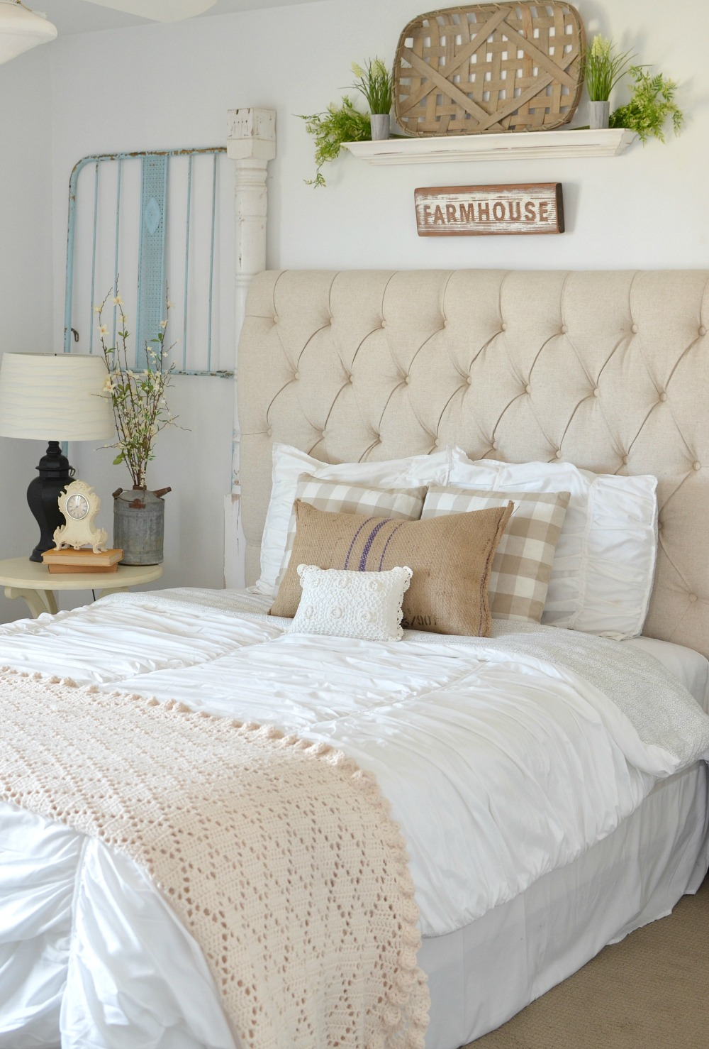 Vintage crib frames in cozy guest bedroom for Farmhouse style bed