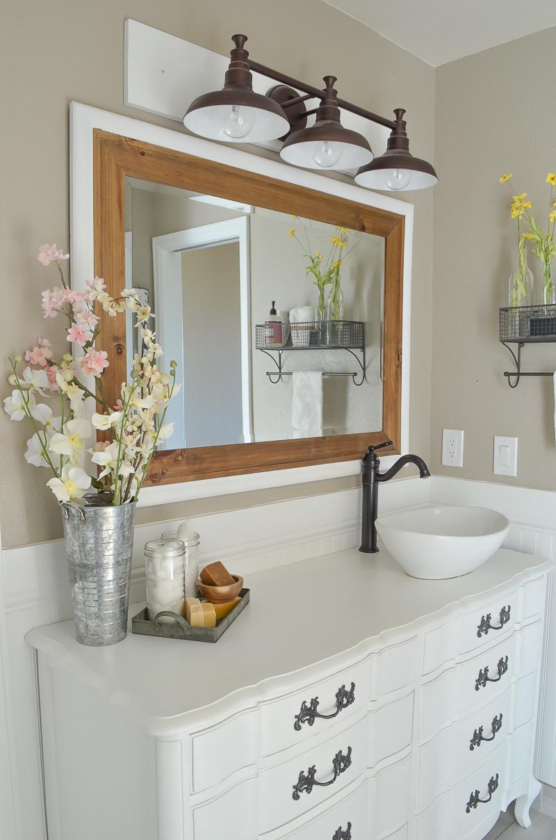 Farmhouse style bathroom makeover. Old dressers used as bathroom vanities.