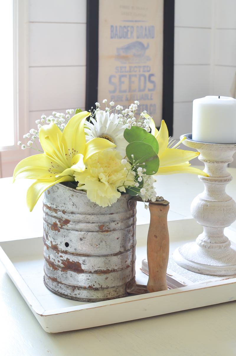 Vintage sifter turned flower vase. Easy DIY farmhouse decor idea.