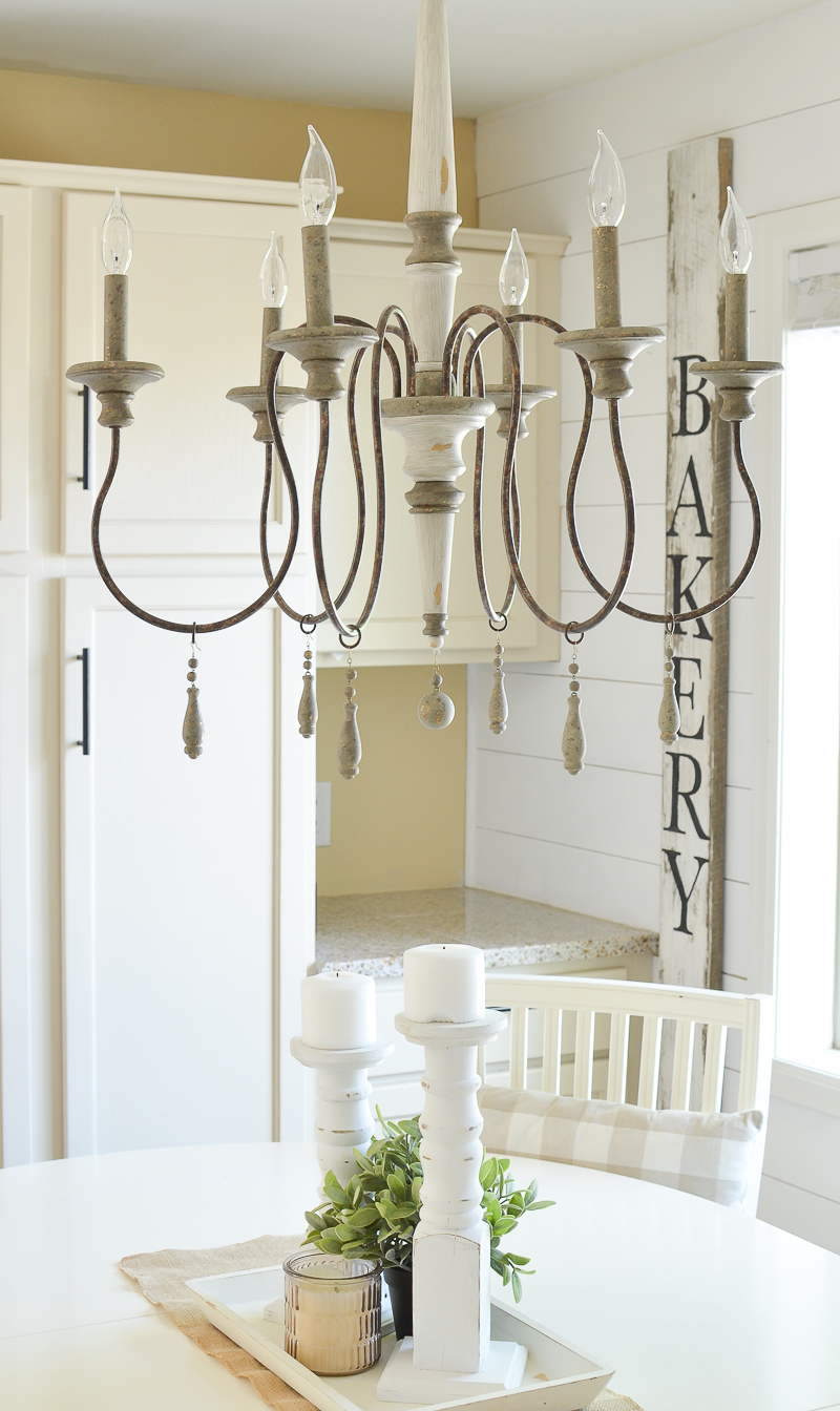 Farmhouse style breakfast nook and vintage chandelier