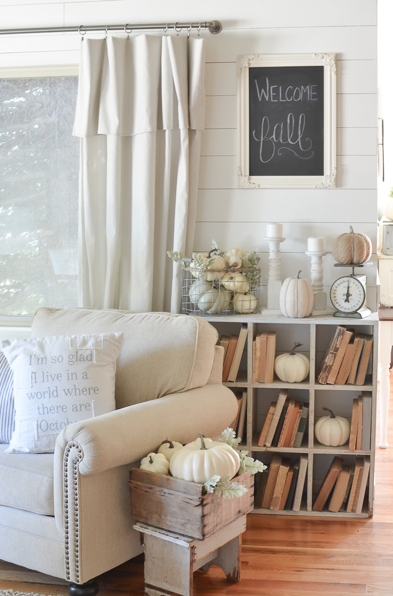 Farmhouse style fall decor and vintage cubby with old books