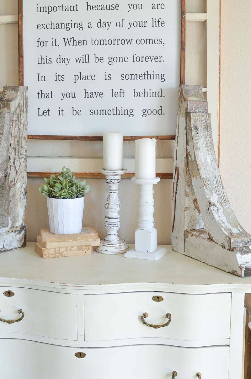 Farmhouse style decor with antique corbels, an old window and vintage dresser.