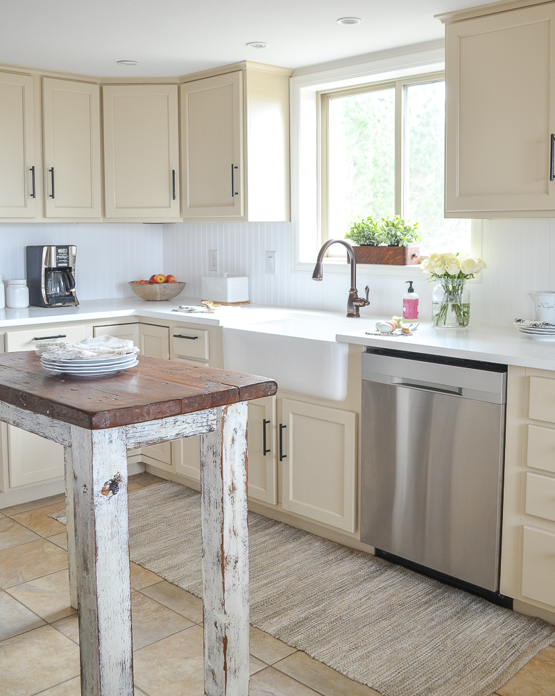 Farmhouse style kitchen makeover with white quartz countertops and farmhouse sink