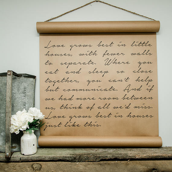 Farmhouse style scroll with love grows best in little houses saying.