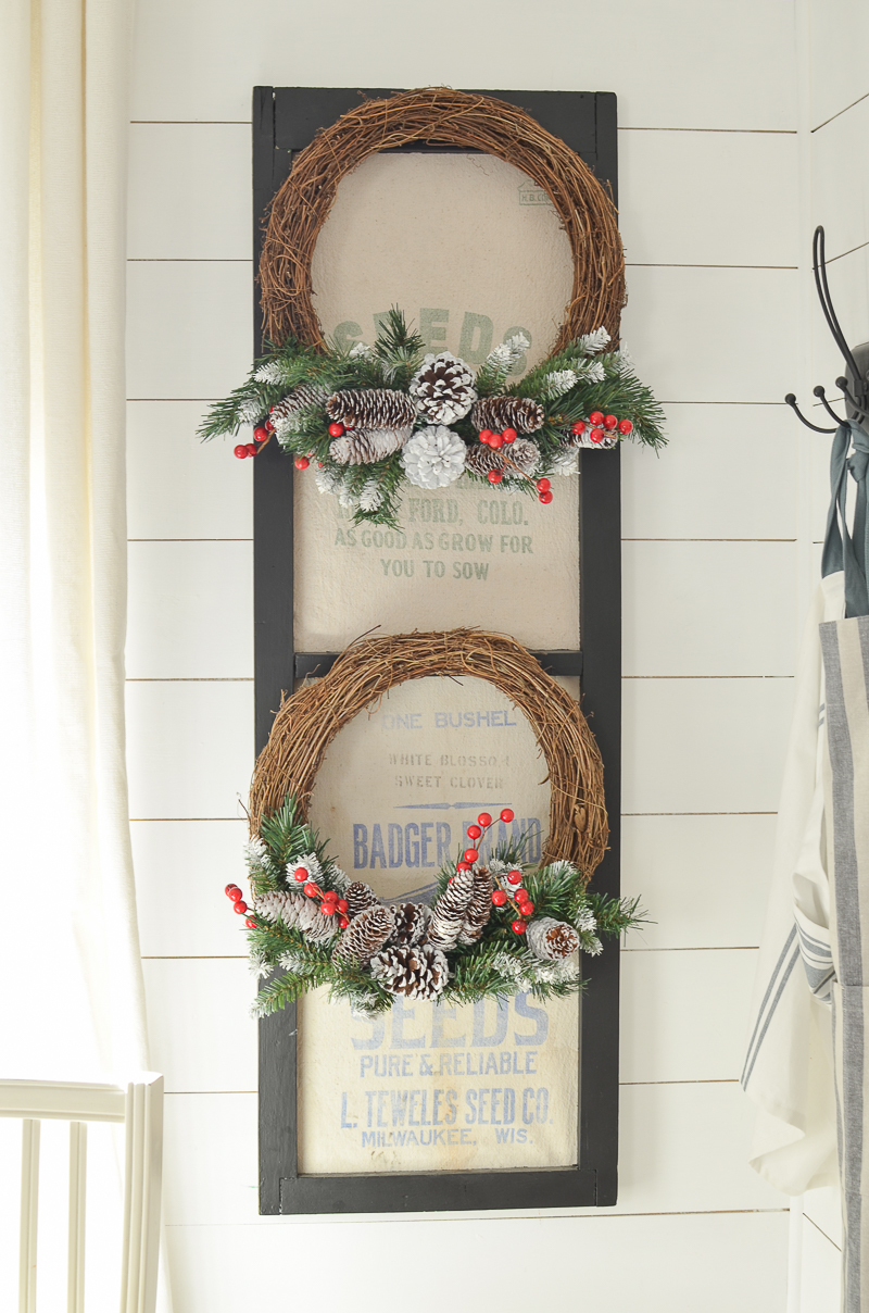 Farmhouse Christmas wreaths on an old vintage window.