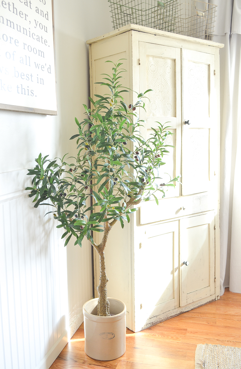faux olive tree in the dining room