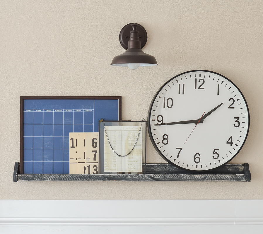 Farmhouse style shelf with layered decor and oversized clock!
