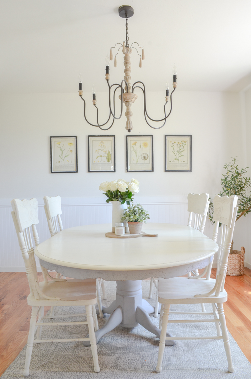 Farmhouse style dining room with botanical prints.