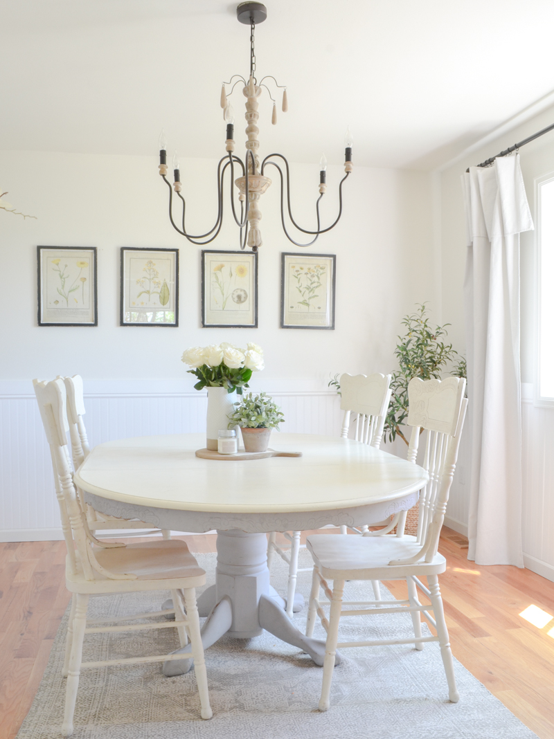 Simple farmhouse style dining room with botanical prints