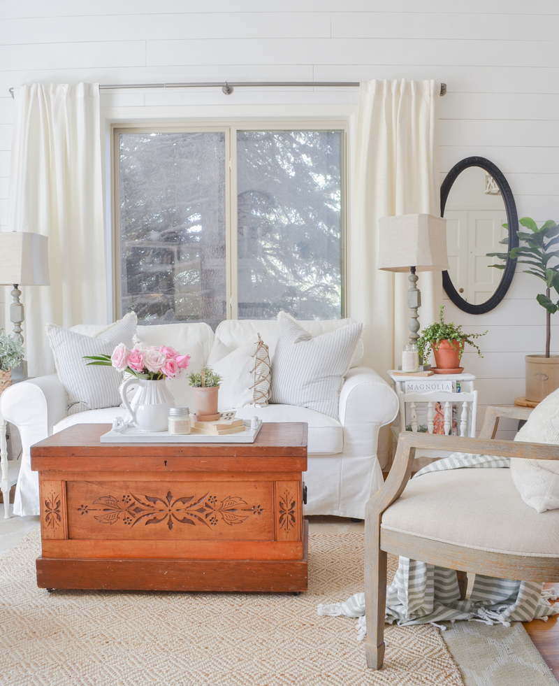 Farmhouse style living room decor. Vintage trunk in front room.