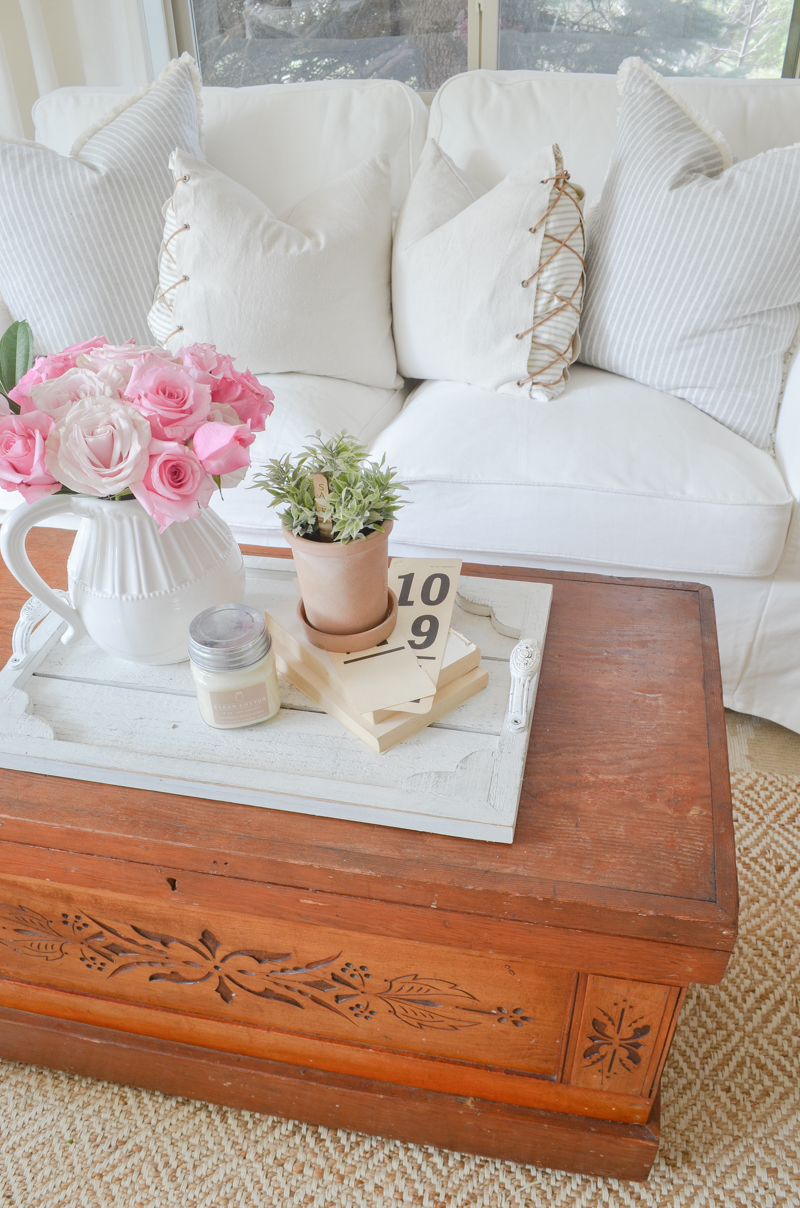 Vintage trunk used as coffee table. Farmhouse style living room decor.