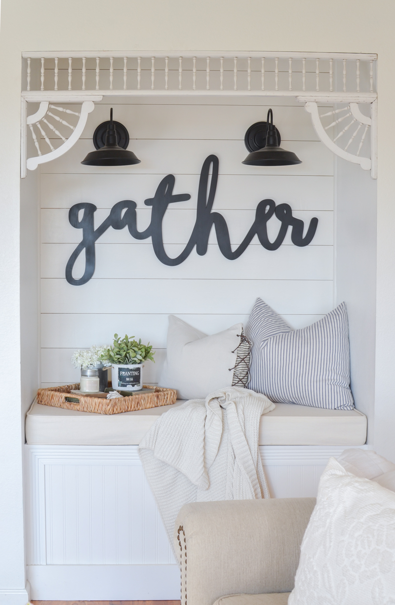Farmhouse style reading nook with vintage corbels. Cozy living room decor ideas!