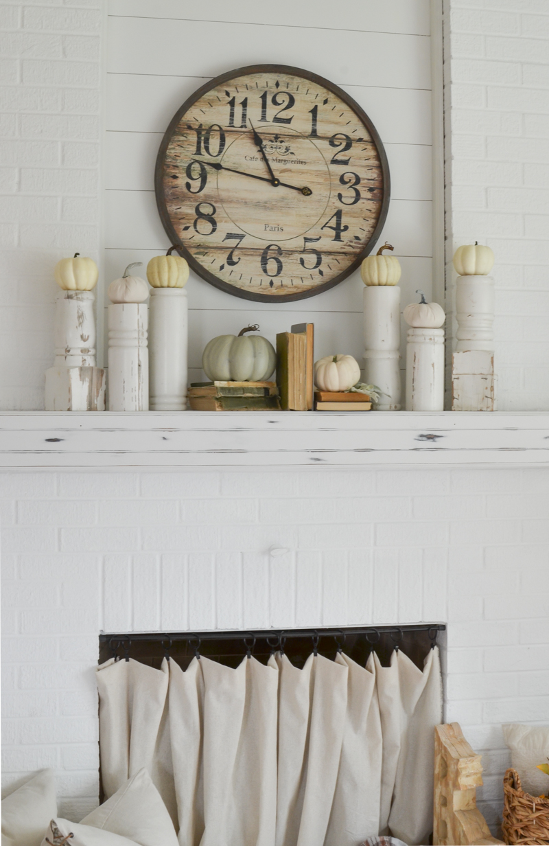Easy DIY Vintage Pumpkin Stand. Easy fall decor idea using a vintage porch posts to hold mini pumpkins.